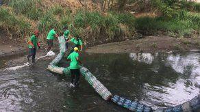 Convenio permitirá que reos conmuten su pena con la recolección de residuos