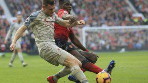 Liverpool empata ante Man U y recupera el 1er puesto