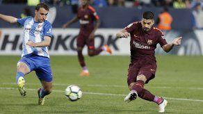 Barcelona gana en Málaga sin Messi y acelera por la liga