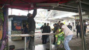 Buhoneros de San Miguelito amanecieron encadenados en rechazo a desalojos