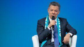 Santos lleva a Alemania su fe en un proceso de paz que lega a su sucesor