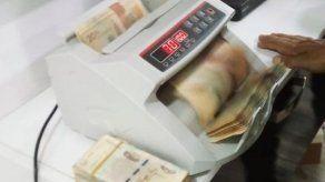 Hallan en Colombia escondite de la mafia con 2.3 millones de dólares en efectivo