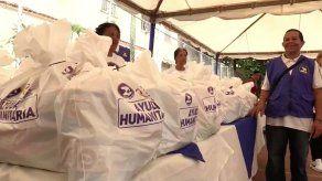 Oposición venezolana entrega ayuda con kits de higiene a más de 500 familias