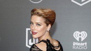 Amber Heard coincide con su antigua hijastra Lily-Rose Depp en una fiesta
