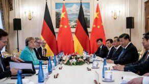 Xi destaca ante Merkel su postura común con Europa de apoyar libre comercio