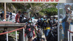 Las autoridades de Panamá lidian con la creciente llegada a través de la peligrosa selva del Darién, la frontera con Colombia, de migrantes, especialmente haitianos, que viajan hacia EE. UU.